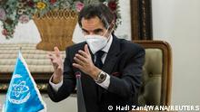 International Atomic Energy Agency (IAEA) Director General Rafael Grossi gestures as he wears a mask during a meeting with head of Iran's Atomic Energy Organization Ali-Akbar Salehi, in Tehran, Iran February 21, 2021. Hadi Zand/WANA (West Asia News Agency) via REUTERS ATTENTION EDITORS - THIS IMAGE HAS BEEN SUPPLIED BY A THIRD PARTY.