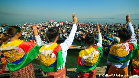 Children wearing a Shan flag give a three finger salute
