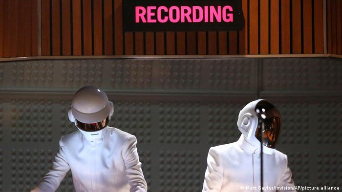 Daft Punk Guy-Manuel de Homem-Christo and Thomas Bangalter performing with 'Recording' sign in the background