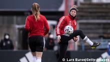 February 18, 2021*** COLOGNE, GERMANY - FEBRUARY 18: Alexandra Popp warms up with team mates during a training session at Suedstadion on February 18, 2021 in Cologne, Germany.Germany plays the 'Three Nations. One Goal'- tournament with the Netherlands and Belgium in the upcoming days. (Photo by Lars Baron/Getty Images)