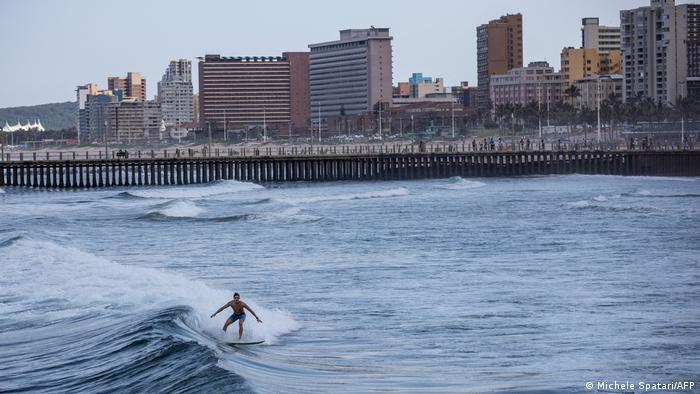 A surfer rides a wave at Durban's North Beach