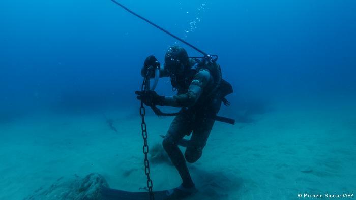 Shark activist Walter Bernardis pulls the hook anchoring a shark net during a dive in Umkomaas