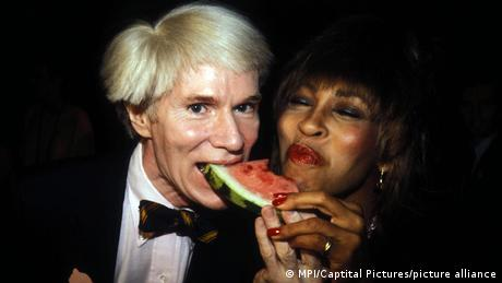 Andy Warhol and Tina Turner sharing a slice of watermelon, 1981