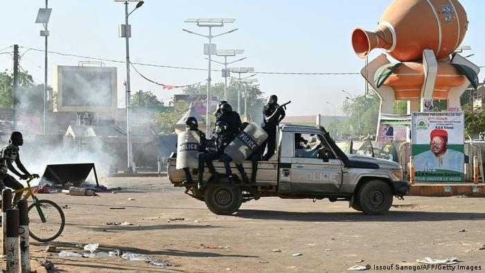 Nigerien police on a pick-up truck during a protest.