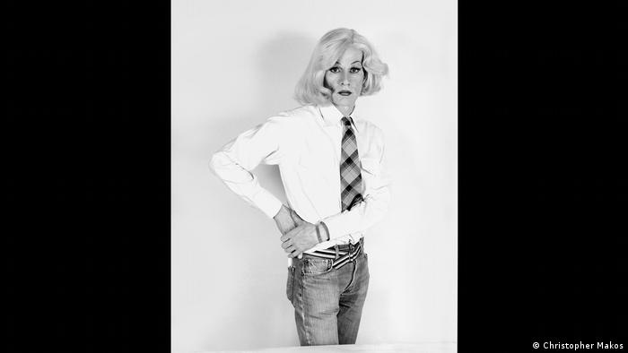 Photo of Andy Warhol wearing a wig