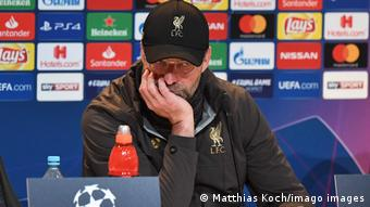 Jürgen Klopp looks unimpressed at a press conference