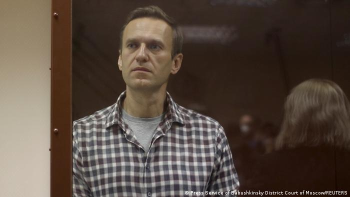 Alexei Navalny stands in court in Moscow, Russia