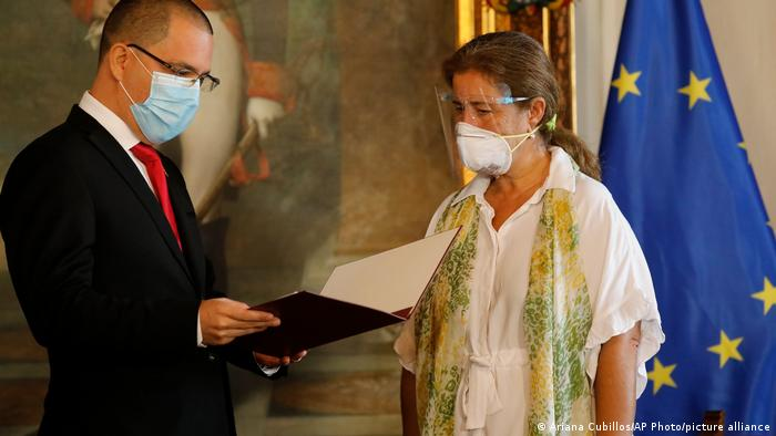 European Union Ambassador to Venezuela Isabel Brilhante Pedrosa is presented with a letter of persona non grata from Venezuelan Foreign Minister Jorge Arreaza at his office in Caracas,