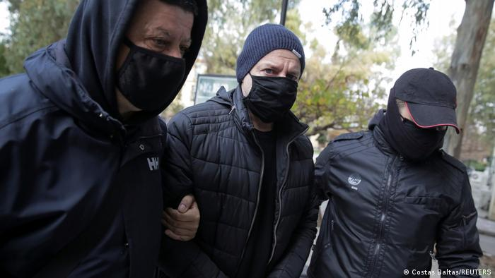 Dimitris Lignadis being taken into custody