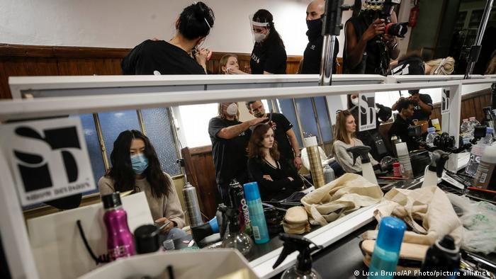 Models get make-up done in the backstage prior to the start of the Black Lives Matter Fall/Winter 2021/22 collective fashion show