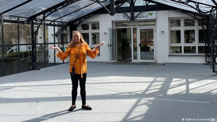 Manuela Baier at the entrance of her hotel