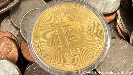 The Bitcoin symbol, surrounded by other coins