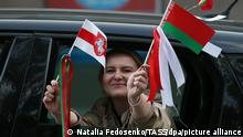 MINSK, BELARUS - SEPTEMBER 12, 2020: A woman with a Belarusian and a red and white flag waves from a car during Women's March in support of opposition in central Minsk. Since the announcement of the 2020 Belarusian presidential election results on August 9, mass protests against the election results have been erupting in major cities across Belarus. According to the Central Election Commission of Belarus, incumbent president Alexander Lukashenko got 80.1% of the vote. Natalia Fedosenko/TASS
