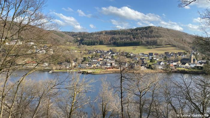 Eifel hills and lake and a village