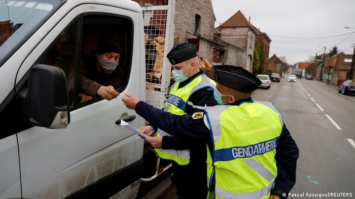 French officials check cars at the French-Belgian border in Maulde