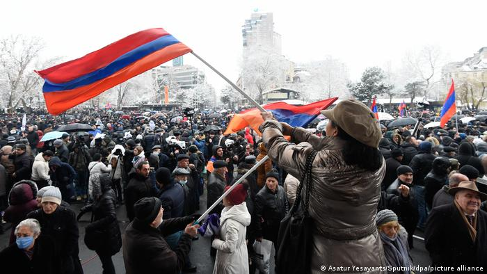 anti-government protesters in capital Yerevan wave flags
