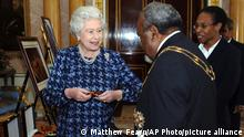 Britain's Queen Elizabeth II meets Prime Minister of Papua New Guinea the Rt. Hon. Sir Michael Somare at Buckingham Palace, London, Tuesday Nov 22, 2005. Sir Michael presented the Queen with the Sovereign's Badge of the Order of Logohu, which she holds in her hand. (AP Photo/Matthew Fearn, Pool)