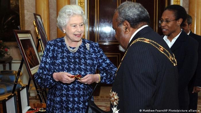 Britain's Queen Elizabeth II meets Prime Minister of Papua New Guinea the Rt. Hon. Sir Michael Somare at Buckingham Palace, London, Tuesday Nov 22, 2005. Sir Michael presented the Queen with the Sovereign's Badge of the Order of Logohu, which she holds in her hand.
