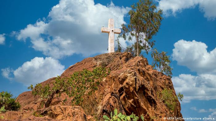 White cross on hill in top of May Shum, Queen Of Sheba Swimming Pool, Aksum Ethiopia