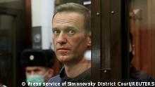 Alexei Navalny sits in court