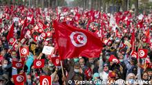 TUNIS, TUNISIA - FEBRUARY 27: Supporters of Ennahda Movement rally to demand the end of political crisis in the country as the cabinet revision issue between President of Tunisia, Kais Saied and Prime Minister of Tunisia, Hichem Mechichi continues in Tunis, Tunisia, on February 27, 2021. Yassine Gaidi / Anadolu Agency