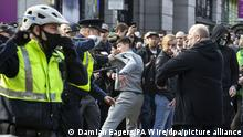 Protesters clashing with Gardai during an anti-lockdown protest in Dublin city centre.