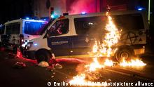 A police van is set on fire as protestors throw molotov cocktails at police during clashes following a protest condemning the arrest of rap singer Pablo Hasél in Barcelona, Spain.