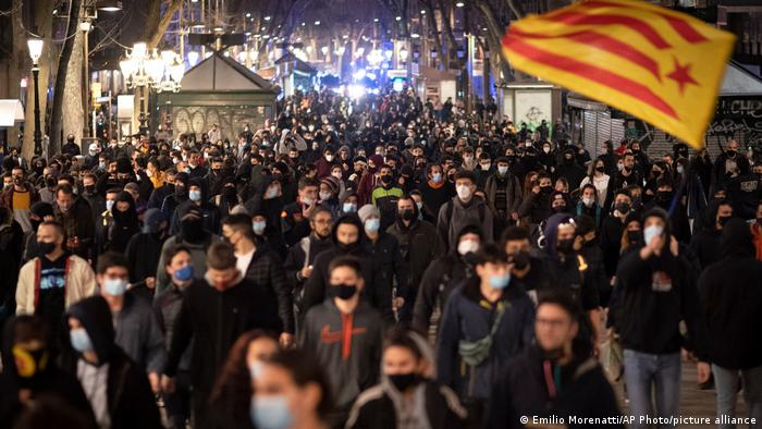 Protesters march along Las Ramblas during a protest condemning the arrest of rap singer Pablo Hasél in Barcelona, Spain.