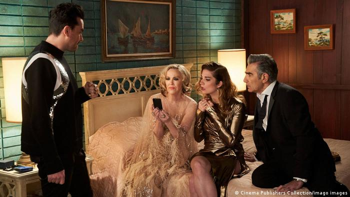 A scene from the film Schitt's Creek features the family dressed expensively in a small room.