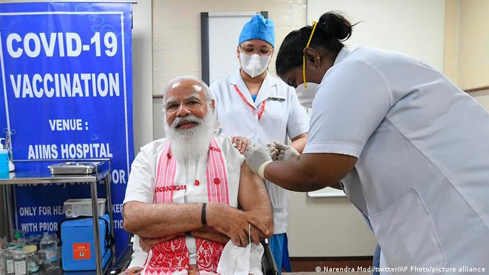 India's Prime Minister Narendra Modi getting a jab of Covaxin, an indigenously developed vaccine
