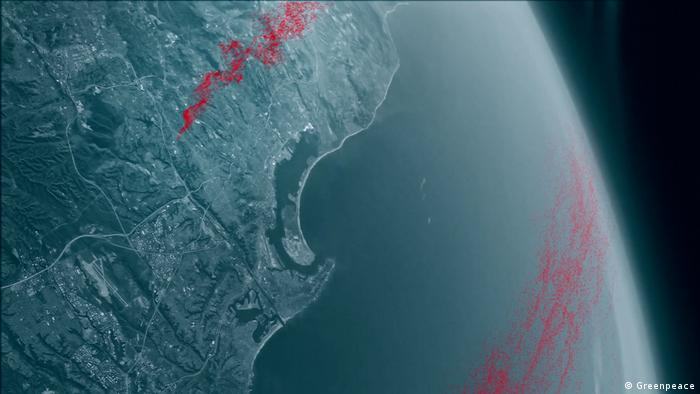 A satellite image of earth. Red dots represent contamination with PFAS