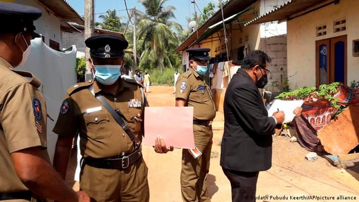 Sri Lankan police outside the house of the self-proclaimed exorcist