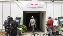 People walk into a covid vaccination center in Ivory Coast.