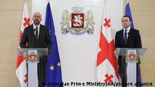 TBILISI, GEORGIA - MARCH 01: (----EDITORIAL USE ONLY – MANDATORY CREDIT - GEORGIAN PRIME MINISTRY / HANDOUT - NO MARKETING NO ADVERTISING CAMPAIGNS - DISTRIBUTED AS A SERVICE TO CLIENTS----) Georgian Prime Minister Irakli Garibashvili (R) and European Council President Charles Michel (L) hold a joint press conference after their meeting in Tbilisi, Georgia on March 01, 2021. Georgian Prime Ministry / Anadolu Agency