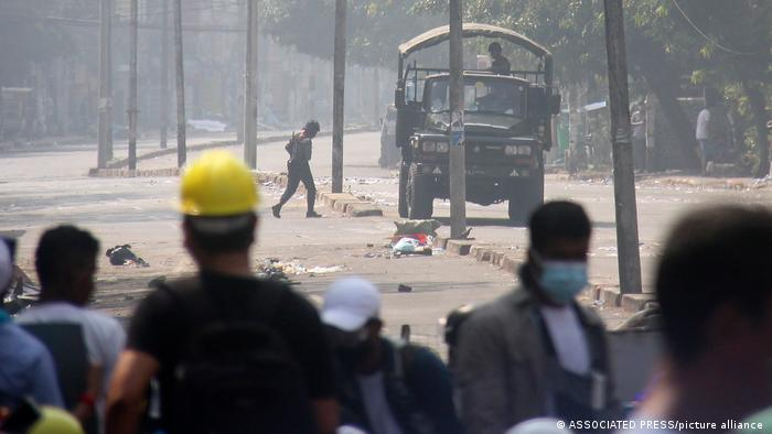 Protesters check a police truck's movement during an anti-coup protest on a blocked road in Mandalay on Tuesday, March 2. Protesters also marched through the streets of Dawei, a small city in southeastern Myanmar that has seen almost daily large protests against military rule.