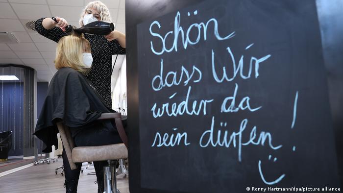 A woman getting her hair cut in a German hair salon