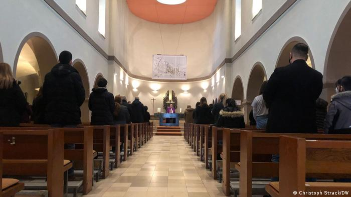 Mass being held in the 'Vom guten Hirten' church in Berlin-Marienfelde