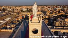 This picture taken February 24, 2021 shows an aerial view of the statue of the Virgin Mary at the Syriac Catholic Church of the Immaculate Conception (al-Tahira-l-Kubra), in the predominantly Christian town of Qaraqosh (Baghdeda), in Nineveh province, some 30 kilometres from Mosul. - Iraq's northern province of Nineveh is the heartland of the country's Christian community and its capital, Mosul, is where the Islamic State group chose to announce the establishment of its self-styled caliphate in 2014. About 30 kilometres (20 miles) to the south lies Qaraqosh, also known as Baghdeda and Hamdaniya, which has a long pre-Christian history but whose residents today speak a modern dialect of Aramaic, the language of Jesus Christ. (Photo by Zaid AL-OBEIDI / AFP) (Photo by ZAID AL-OBEIDI/AFP via Getty Images)