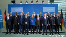 BERLIN, GERMANY - JANUARY 19: Participants, including (from L to R, first row) British Prime Minister Boris Johnson, Turkish President Recep Tayyip Erdogan (3rd from L), French President Emmanuel Macron, German Chancellor Angela Merkel, United Nations Secretary-General Antonio Guterres, Russian President Vladimir Putin and Egyptian President Abdel Fattah el-Sisi, as well as U.S. Secretary of State Mike Pompeo (C, 2nd row), and Italian Prime Minister Giuseppe Conte (2nd row, 2nd from R) pose for a group photo at an international summit on securing peace in Libya at the Chancellery on January 19, 2020 in Berlin, Germany. Leaders of nations and organizations linked to the current conflict are meeting to discuss measures towards reaching a consensus between the warring sides and ending hostilities. (Photo by Sean Gallup/Getty Images)