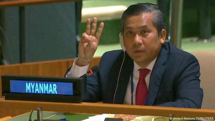 Myanmar's ambassador to the United Nations Kyaw Moe Tun holds up three fingers in solidarity with protesters at the end of his speech to the General Assembly.