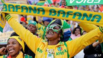 South Africa soccer fans, one holding the team scarf, cheer before the World Cup group A soccer match between South Africa and Mexico at Soccer City in Johannesburg, South Africa, Friday, June 11, 2010. (AP Photo/Matt Dunham)