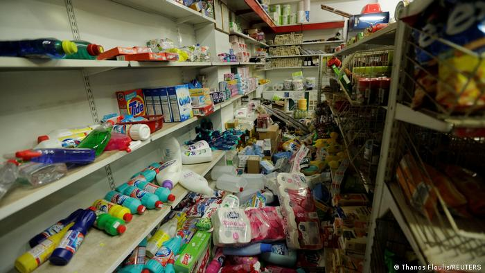 Products are seen on the floor of a supermarket, following the quake