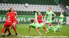 Wolfsburg's Alexandra Popp scores a spectacular overhead kick.