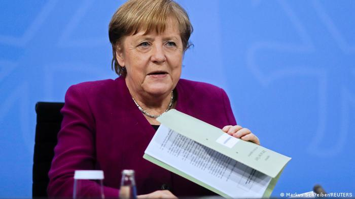 German Chancellor Angela Merkel attends a news conference after a meeting with state leaders to discuss options beyond the end of the pandemic lockdown