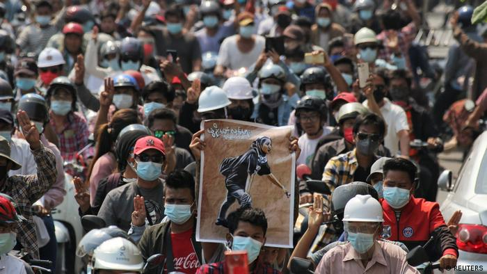 People attend the funeral of Angel a 19-year-old protester also known as Kyal Sin who was shot in the head as Myanmar forces opened fire to disperse an anti-coup demonstration in Mandalay, Myanmar, March 4, 2021.