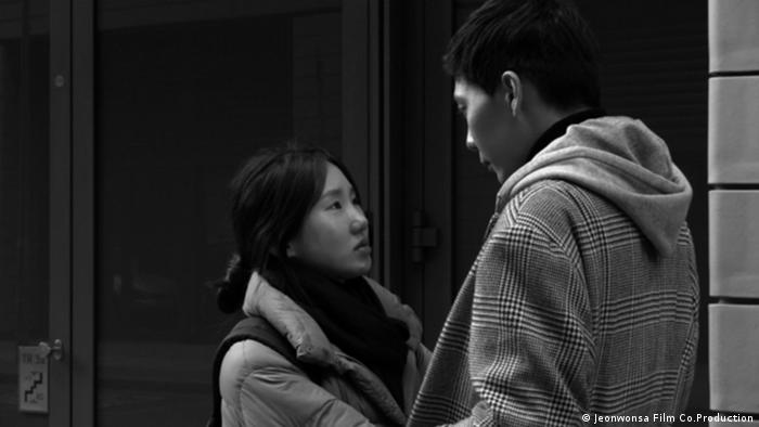 Film still 'Introduction': A couple looking at each other, black-and-white photo.
