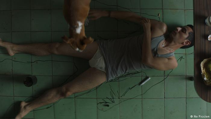 Film still 'A Cop Movie' crime scene, a man lying on a tiled floor.