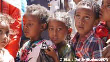She identified children in need and is trying to do her part to prevent looming malnutrition. These displaced children are waiting in line with their parents for a macaroni distribution. Mekele, February 26th, 2021. Photo: Maria Gerth-Niculescu/DW