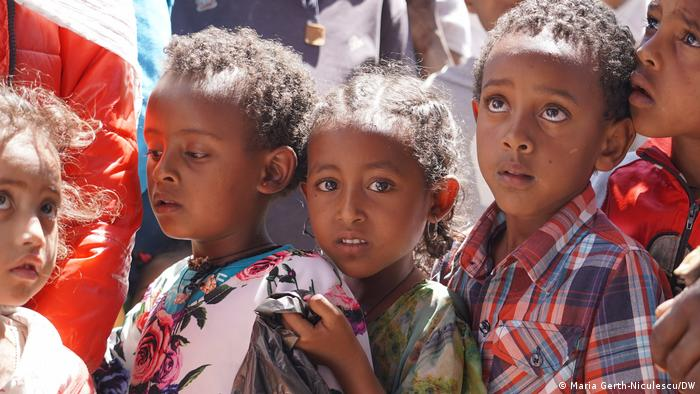 Tigrayan children line up for food.