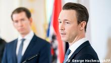 (FILES) In this file photo taken on March 18, 2020 (L-R) Austrian Chancellor Sebastian Kurz listens as Austrian Finance Minister Gernot Bluemel addresses a press conference on the developments related to to the coronavirus (Covid-19) at the Chancellery in Vienna. - The house of one of the ministers closest to Austrian Chancellor Sebastian Kurz was searched on February 11, 2021 as part of a probe into possible party financing offences, prosecutors said. The specialised anti-corruption prosecutors' department said in a statement that it was investigating Finance Minister Gernot Bluemel and two other suspects over possible corruption and bribery offences. (Photo by GEORG HOCHMUTH / APA / AFP) / Austria OUT